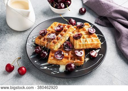 Belgian Fluted Waffles With Fresh Cherries And Cream On A Plate. Soft Homemade Waffles, Sweet Desser