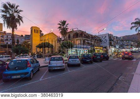 Giardini Naxos, Sicily, Italy - September 24, 2019: Evening Street, Walk Along The Promenade In Ital