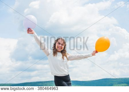 Fly With Helium Balloons. Higher And Higher Everyday. Cheerful Girl Have Fun. Freedom Concept. Happi
