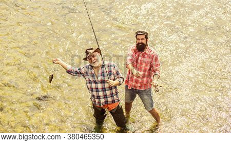 Together We Can Do So Much. Father And Son Fishing. Male Friendship. Family Bonding. Summer Weekend.