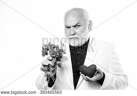 Handsome Bearded Man Wear Tuxedo. Romance And Dating. Man Hold Heart Symbol Of Love. Gentleman Conce