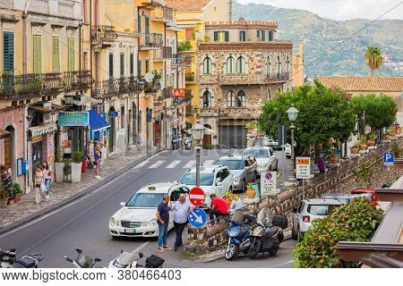 Taormina,, Sicily, Italy - September 26, 2019: Tourists And Locals Walk In The Evening Through The S