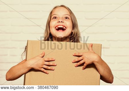 How Home Should Feel. Happy Childhood. Small Girl Child. Little Girl With Box. Moving To New Apartme