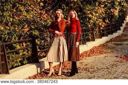 Fall Fashion. Pleated Skirt Fashion Trend. Women Walking In Autumn Park. Autumn Stylish Outfit. Ador