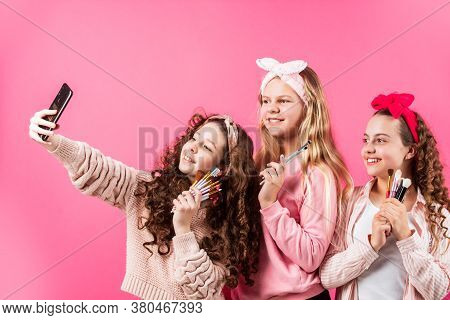 Take Selfie. Girls Friends Have Fun Beauty Salon. Children With Make Up And Healthy Skin. Happy Chil