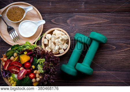 Diet Healthy Food And Lifestyle Health Concept. Sport Exercise Equipment Workout and gym With Nutrit