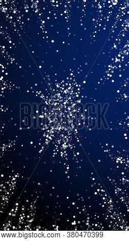 Random White Dots Christmas Background. Subtle Flying Snow Flakes And Stars On Dark Blue Background.