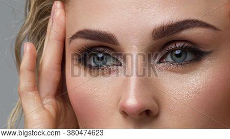 Closeup Female Eyes With Bright Make-up, Great Shapes Brows, Extreme Long Eyelashes. Celebrate Makeu