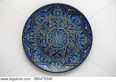 Decorative Ceramic Plate With Black, Blue And Golden Colors, Painted Plate On White Background, Clos