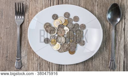 Kazakhstan Tenge In A Plate On The Table.a Lot Of Kazakh Money.sawing The Budget,the Subsistence Min