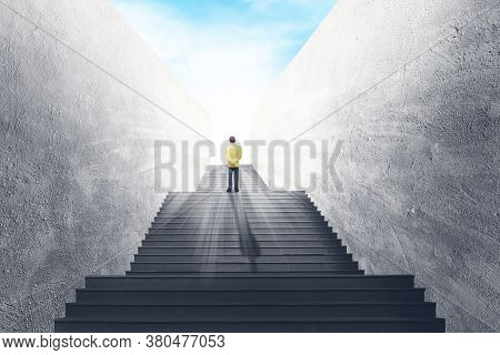 Business Vision And Success Concept : Businessman Standing On Concrete Staircase And Looking Forward