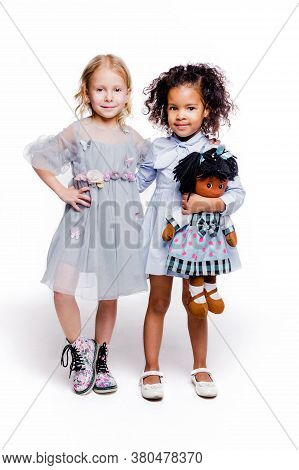 Little Fashionable Girls Are Friends Of Two Different Nationalities. A Girl Of African American Appe
