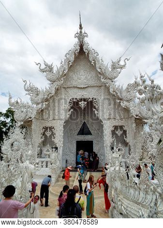 Chiang Rai. Thailand, June 17, 2017: Wat Rong Khun. People Near The Main Gate Of The White Temple In