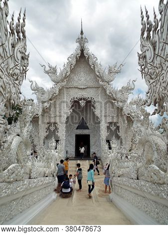 Chiang Rai. Thailand, June 17, 2017: Wat Rong Khun. People In The Hallway Leading To The Entrance Of