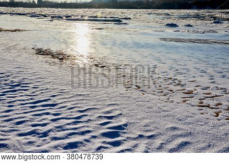 Ice Hummock On Frozen River In Winter Sunny Day. Sparkling Ice Texture Or Background.