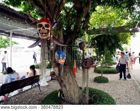 Chiang Rai. Thailand, June 17, 2017: Wat Rong Khun. Modern Patterned Heads Hang From Tree Branches A