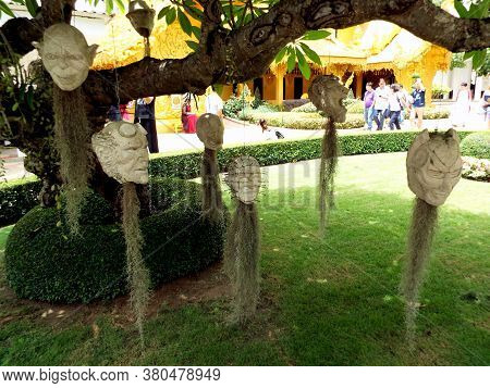 Chiang Rai. Thailand, June 17, 2017: Wat Rong Khun. Modern Character Heads Hang From A Tree At The W