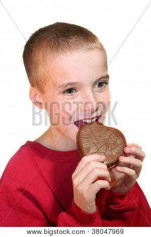 Happy Boy Biting Chocolate Heart