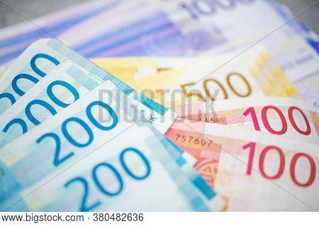 Norwegian Economy Theme. Colorful Norwegian Krones Banknotes On A Table. Cash Money.