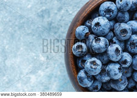Fresh Blueberries In Wooden Bowl Top View