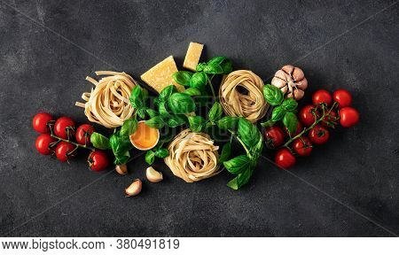 Fettuccine With Ingredients For Cooking Italian Pasta On Dark Background Top View