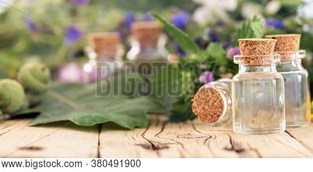 Glass Bottle With Essential Oil Or Oil For Natural Diseases Treatment On Wooden Table With Copy Spac