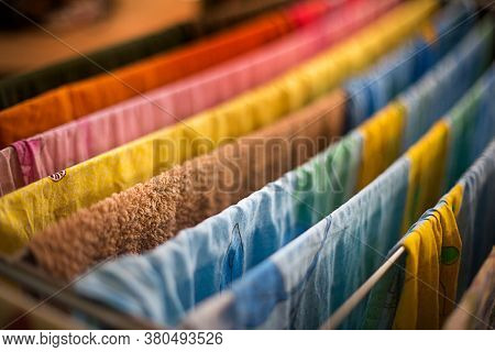 Colorful Underwear Is Hung On The Dryer After Washing. General Cleaning, Laundry Drying, Compact Dry