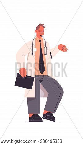 Male Doctor In Uniform Holding Clipboard Healthcare Medicine Concept Man Medical Worker Standing Pos