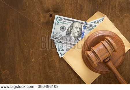 Judges Hammer Paper Envelope With Money Bribery Or Corruption Money Concept