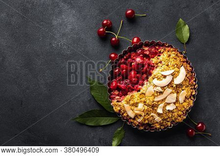 Cooked Cherry Pie Oatmeal Flakes On Dark Background With Copy Space
