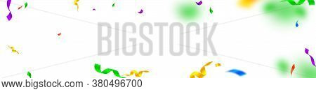 Streamers And Confetti. Festive Streamers Tinsel And Foil Ribbons. Confetti Vignette On White Backgr