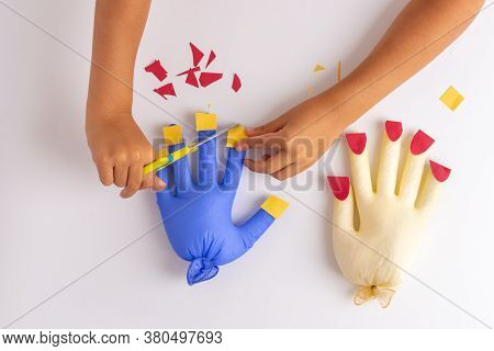 Kids Hand Cutting Paper Artificial Nails On A Toy, Practicing Scissors Skills With A Game, Activitie