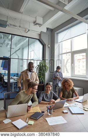 Successful Team In Coworking Space. Vertical Shot Of Multiracial Coworkers Communicating, Sharing Fr