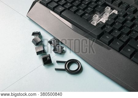 Keyboard, Keys, Brushes And Key For Replacing Keys On A Blue Background. Cleaning Concept. Office Cl