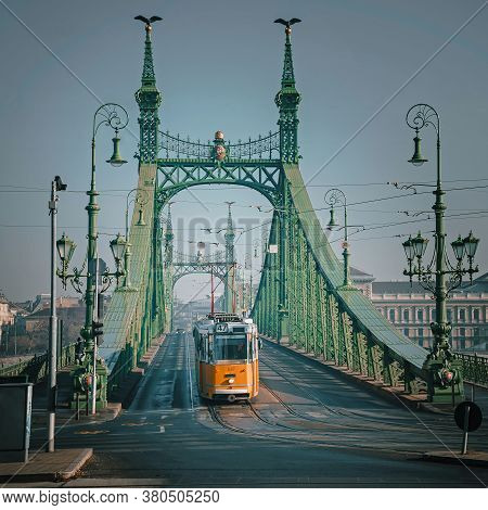 An Yellow Tram To The Liberty Bridge In Budapest.