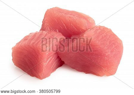 Three Cut Squares Of Raw Turkey Breast Isolated On White. Close Up.