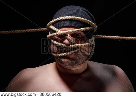 Picture Of Binded Fat Man With Rope On Face