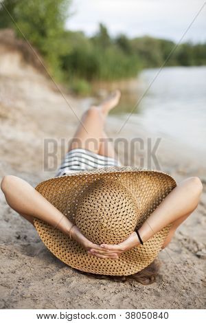 Image Of Relaxing Female In Big Hat