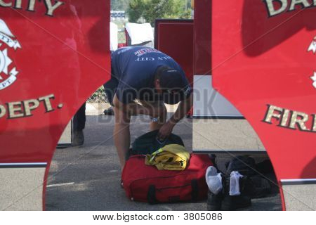 Fireman Preparing To Go Back To Fire