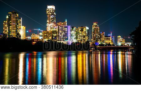 Austin Texas Downtown Nightscape Colorful City Lights Glowing Off The Reflections Of The Colorado Ri