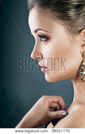 Profile Of A Girl With Earrings