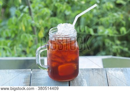 Thai Ice Tea (black Ice Tea) On The Garden Background