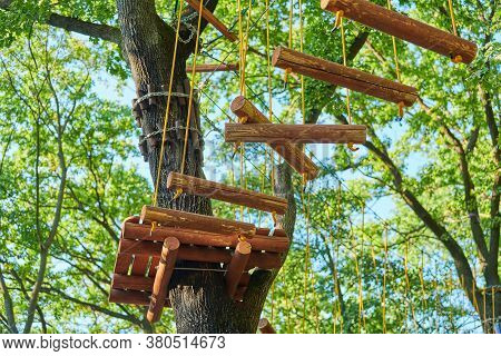 High Ropes Experience Adventure Tree Park. Rope Road Course In Trees. Climbing Adventure Rope Park.