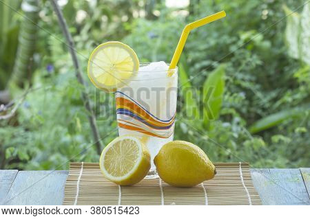 Fresh Lemon Smoothie On The Garden Background