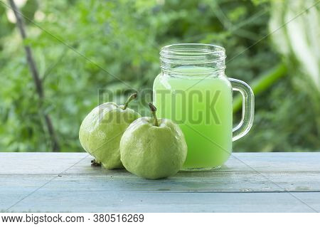 Fresh Guava Fruit And Guava Juice On Table In The Garden Background