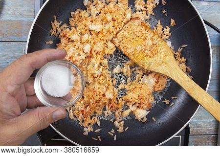 Chef Pouring Sugar To Pan For Cook Fried Rice  / Cooking Fried Rice Concept