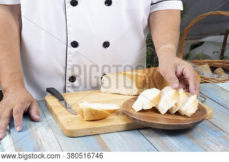 Chef Putting Slide Bread On The Plate / Cooking Garlic Bread Concept