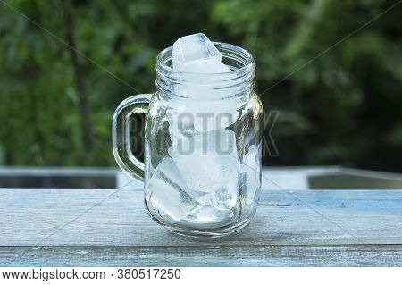 A Glass Of Refreshing Ice Cube On Table