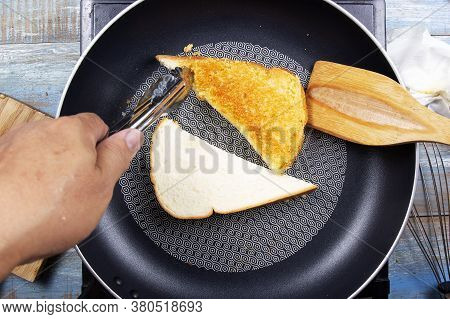 Chef Baking Parmesan Cheese Toast By Pan / Bake Parmesan Cheese Toast By Pan Concept