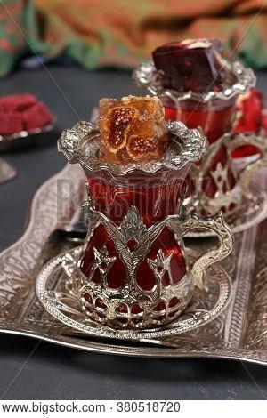 Pomegranate Tea And Turkish Delight On Metal Tray On Dark Background, Closeup